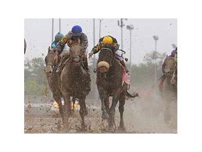 Terrain (blue cap) battles with Papa Clem in the Louisiana Derby.