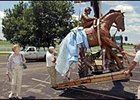 Penny Chenery, who owned Secretariat, watches as a statue of Big Red is unloaded at the Kentucky Horse Park on Wednesday.