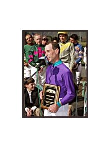 Russell Baze, surrounded by fellow riders after winning the George Woolf Award in 2002.