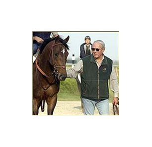 Ten Most Wanted, with trainer Wally Dollase.