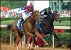 Azeri, left, wears down Take Charge Lady to win the Apple Blossom for the second straight year.