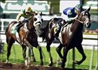 Declan's Moon, right, heads for the win over Going Wild in the Santa Catalina Stakes at Santa Anita.