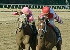 Blind Luck (left) and Havre de Grace fight to the finish of the Delaware Handicap.