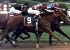 City Zip (9), with jockey Jose Santos aboard, and Yonaguska, right, with jockey Jerry Bailey up, battle to a dead heat in the 96th running of the Grade I Hopeful Stakes Sept. 2, 2000, at Saratoga. Macho Uno, center, was third.