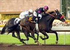 Lava Man and Corey Nakatani, outside, hold off Magnum to win the Santa Anita Handicap.