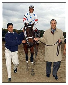 Joe Torre, right, part owner of Sugar Punch, walks the horse to the winner's circle after Sugar Punch, ridden by Edgar Prado, won the Iroquois Stakes at Belmont Park.