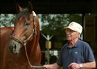 Trainer Scotty Schulhofer, pictured here with his champion Lemon Drop Kid, has passed away at age 80.