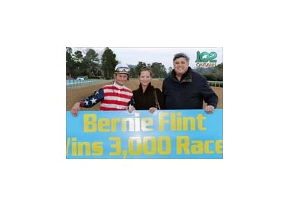 Jockey Calvin Borel and an unidentified friend help trainer Bernie Flint (right) celebrate milestone win.