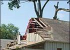 Barn at Saratoga Race Course damaged by Monday storm.