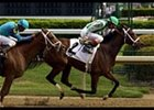 Spain defeats Mystic Lady to set a North American earnings mark for a female horse.
