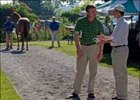 John Ferguson (left) and Bill Farish compare notes about Saratoga sale.