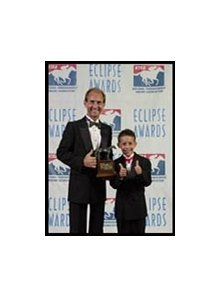Jockey Jerry Bailey, with his son at Eclipse Awards dinner.