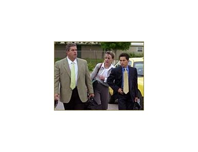 Jockey Jose Santos, right, arrives at the Churchill Downs racing office for a meeting with track stewards along with his attorney Karen Murphy, center, and agent Mike Sellitto.