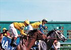 Winning Colors (right) winning the 1988 Kentucky Derby with Gary Stevens in the irons.