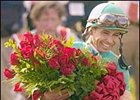 Jockey Mike Smith, with blanket of roses after winning the Kentucky Derby.