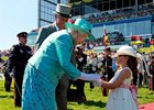 With England's Queen Elizabeth II attending for the first time since 1997, Big Red Mike stole the Queen's Plate with a gate-to-wire win.
