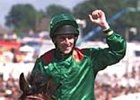 Johnny Murtagh, aboard Sinndar, celebrates winning the Epsom Derby June 10.