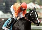 Smokey Stover gets a pat of the back from jockey Aaron Gryder after winning the Sunshine Millions Sprint at Santa Anita.
