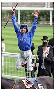 Frankie Dettori celebrates after winning the Queen Anne Stakes with Ramonti.  He later received a suspension for overuse of the whip in the race.