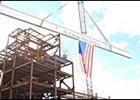 "Beam put in place as part of ""Topping Off"" ceremony at Churchill Downs."