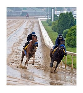 Sidney's Candy (left) splashes through the mud at Churchill Downs on April 24.