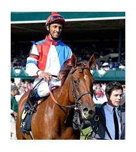 "Groupie Doll and Rajiv Maragh after winning the Thoroughbred Club of America.<br><a target=""blank"" href=""http://photos.bloodhorse.com/AtTheRaces-1/at-the-races-2012/22274956_jFd5jM#!i=2132898611&k=wrPtZ53"">Order This Photo</a>"