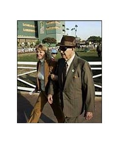 Noble Threewitt walks with his granddaughter-in-law Patricia Chinnici Friday at Santa Anita.