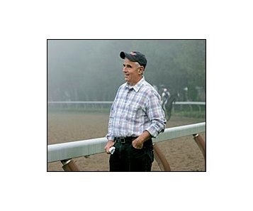 Hall of Fame trainer Nick Zito, watches horses train at Saratoga.