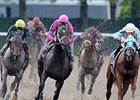 "Charitable Man (pink silks) takes control in the Peter Pan.<br><a target=""blank"" href=""http://www.bloodhorse.com/horse-racing/photo-store?ref=http%3A%2F%2Fpictopia.com%2Fperl%2Fgal%3Fprovider_id%3D368%26ptp_photo_id%3D8086154%26ref%3Dstory"">Order This Photo</a>"