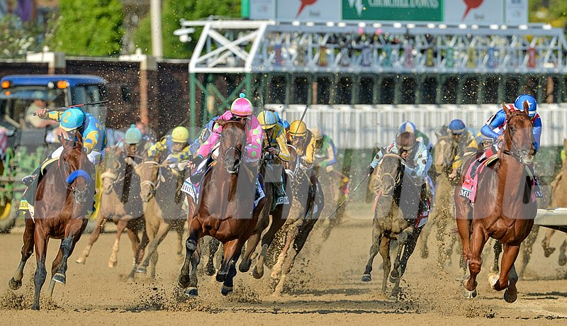 American Pharoah battles for the lead in the final turn of the 2015 Kentucky Derby.