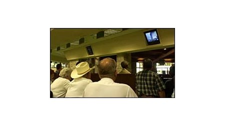 Horsemen watch the television at Keeneland in the van counter area as news of terrorist attacks are relayed to the world on Tuesday morning, Sept. 11, 2001.