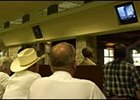 Horsemen watch the television at Keeneland as news of terrorist attacks are relayed to the world on Tuesday morning, Sept. 11, 2001.