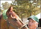 Azeri, with trainer D. Wayne Lukas, at Oaklawn Park earlier this year.