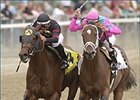 Ghostzapper, left, beats Saint Liam to the wire in the 51st running of the Woodward, Saturday at Belmont.