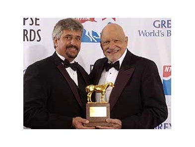 Steve Asmussen and Jess Jackson pose with Curlin's 2008 Horse of the Year Eclipse Award