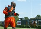 Cincinnati Bengals wide receiver Chad Johnson wins his match race with Restore the Roar.