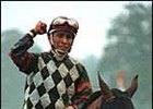 Jockey Edgar Prado celebrates his victory aboard Lemon Drop Kid in the Whitney Handicap at Saratoga.