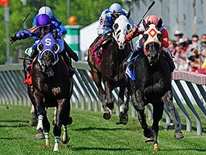 Ben's Cat (right) catches Bold Thunder late to win the Jim McKay Turf Sprint.