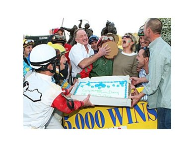 Tim Doocy is 'congratulated' for his 5,000th win.