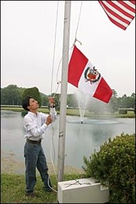 Jockey Rafael Bejarano raises the flag at River Downs Monday.