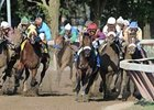 Colonel John (white cap, second from rail) had an eventful trip in his Travers' (gr. I) win.