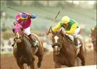 A.P. Adventure, right, holds off a persistent Hollywood Story to win the Las Virgenes Stakes, Sunday at Santa Anita.