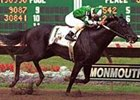 Rize, ridden by Jose C. Ferrer, wining the $350,000 Philip H. Iselin Handicap at Monmouth Park Aug. 27, 2000.