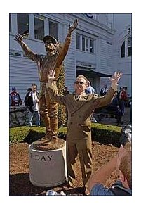 Hall of Fame Jockey Pat Day poses next to the Raymond Graf statue commemorating his 1992 Kentucky Derby win.