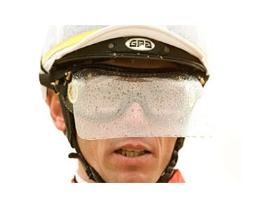 Garrett Gomez wears a plastic safety visor to help protect his face from kickback at Santa Anita.