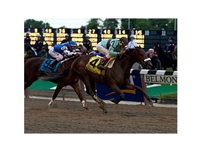 Birdstone goes by Smarty Jones to win the 2004 Belmont Stakes.