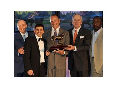 The Biofuel team accepts the Horse of the Year trophy. (L-R) Trainer Reade Baker, Jockey Eurico Rosa da Silva, Presenter Jim Lawson, Breeder/Owner Bereton Jones, and Assistant Trainer Leroy Trotman.