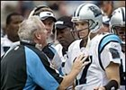 Carolina Panthers quarterback Jake Delhomme, right, talking to coach John Fox.
