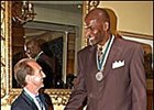 Jockey Jerry Bailey, left, with veteran NBA player Robert Parrish at the Great Sports Legends dinner.