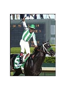 Victor Espinoza celebrates as War Emblem wires the field in the 2002 Kentucky Derby.
